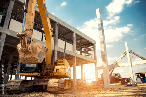 construction equipment in construction new warehouse background Fototapet