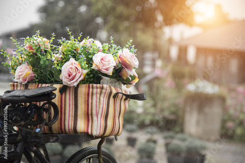 Printed kitchen splashbacks Bicycle Old bicycle decorated with flowers during raining time