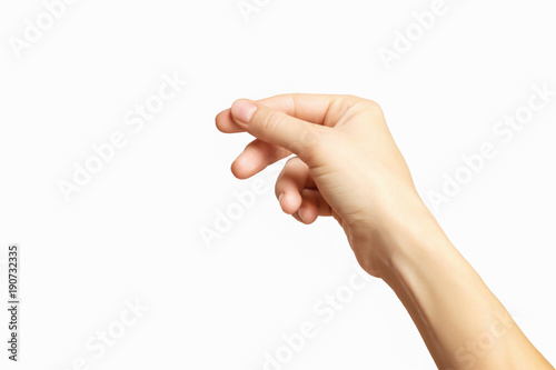 Obraz Closeup empty female hand holding invisible business card isolated at white background. - fototapety do salonu