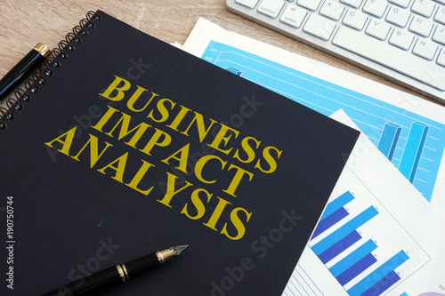 Business impact analysis (BIA) on a office desk. Wallpaper Mural