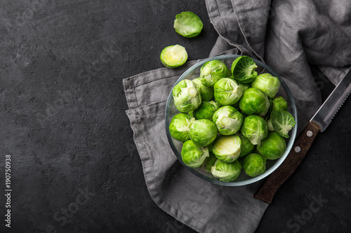 Photo Stands Brussels fresh raw brussel sprouts in glass bowl.