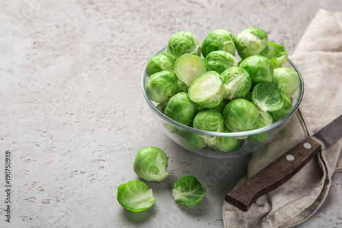 Bruxelles fresh raw brussel sprouts in glass bowl.