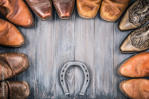 Wild West wooden background concept with retro leather cowboy boots and the horseshoe Tapéta, Fotótapéta