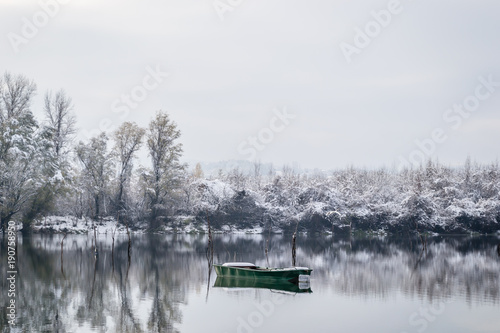 Forgotten boat on the lake shore