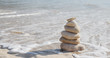 Stack of several rocks on a pebble sea beach