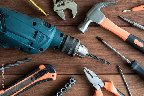 Fotografia  Set of work tools on wooden background