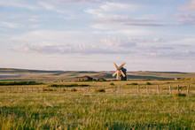Alone Windmill In Desolate Field