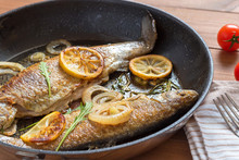 Fried Trout Fish On Frying Pan.
