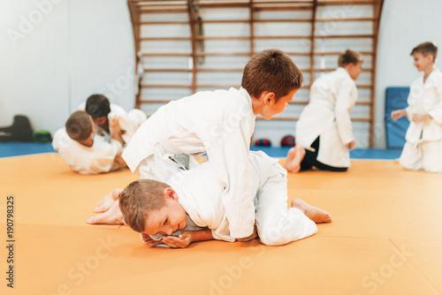 Photo Stands Martial arts Boys in uniform practice martial art