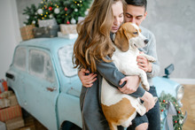Young Couple With Beagle And R...