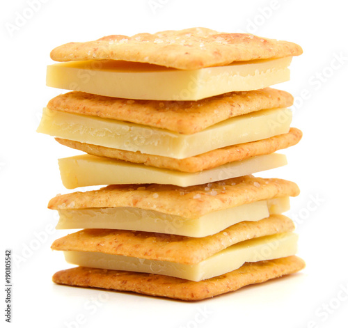 Vászonkép Delicious crackers with cheese on white background