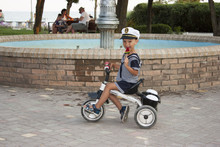 Boy Child 4 Years Old With Candy On A Bicycle
