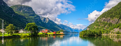 Deurstickers Scandinavië Amazing nature view with fjord and mountains. Beautiful reflection. Location: Scandinavian Mountains, Norway. Artistic picture. Beauty world. The feeling of complete freedom