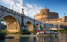 Boat On The Tiber River Near Sant Angelo Bridge And Castle In Rome, Italy