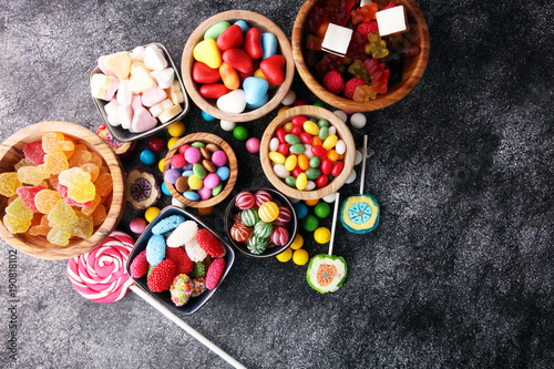 Poster Confiserie candies with jelly and sugar. colorful array of different childs sweets and treats
