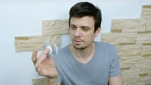 The Man Spins The Spinner And Look At Him. Hypnosis From The Spinner 4K