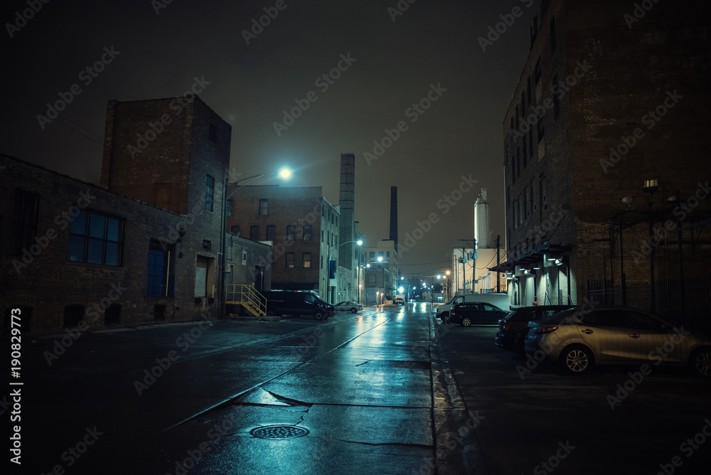Fototapety, obrazy: Foggy industrial urban street city night scenery in Chicago with vintage warehouses, factories and smokestacks after a rain.