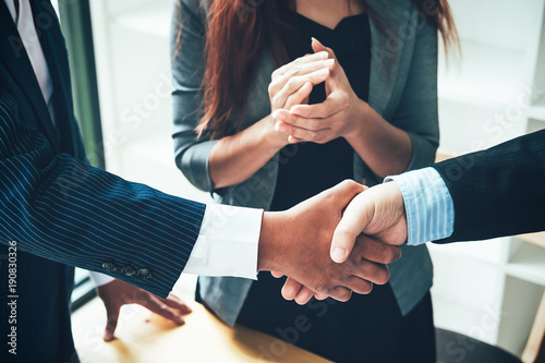 Fototapety, obrazy: Asian Businessman handshake and business people. Business executives to congratulate the joint business agreement.Vintage tone Retro filter effect,soft focus,low light.