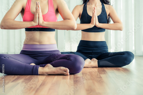 Keuken foto achterwand Ontspanning Women practicing yoga pose in fitness gym class