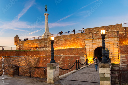 Fotobehang Praag Kalemegdan fortress with kings gates and Victor the monument in evening colors