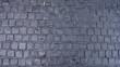 Black cobbled stone road background pavement texture