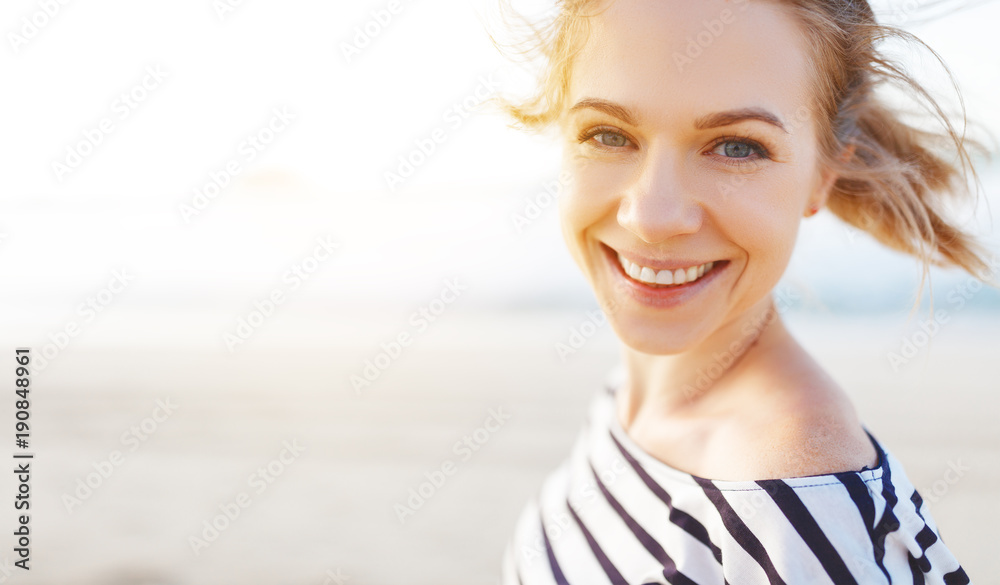 Fototapeta happy woman enjoying freedom and laughs on sea - obraz na płótnie