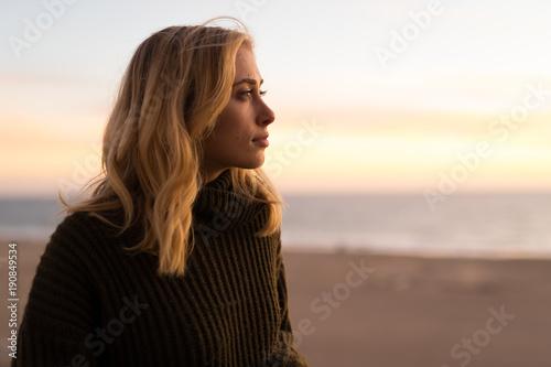 Young caucasian woman looking far away