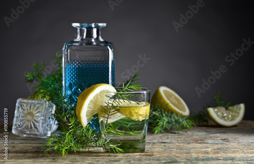 Cocktail with blue gin , tonic and lemon .
