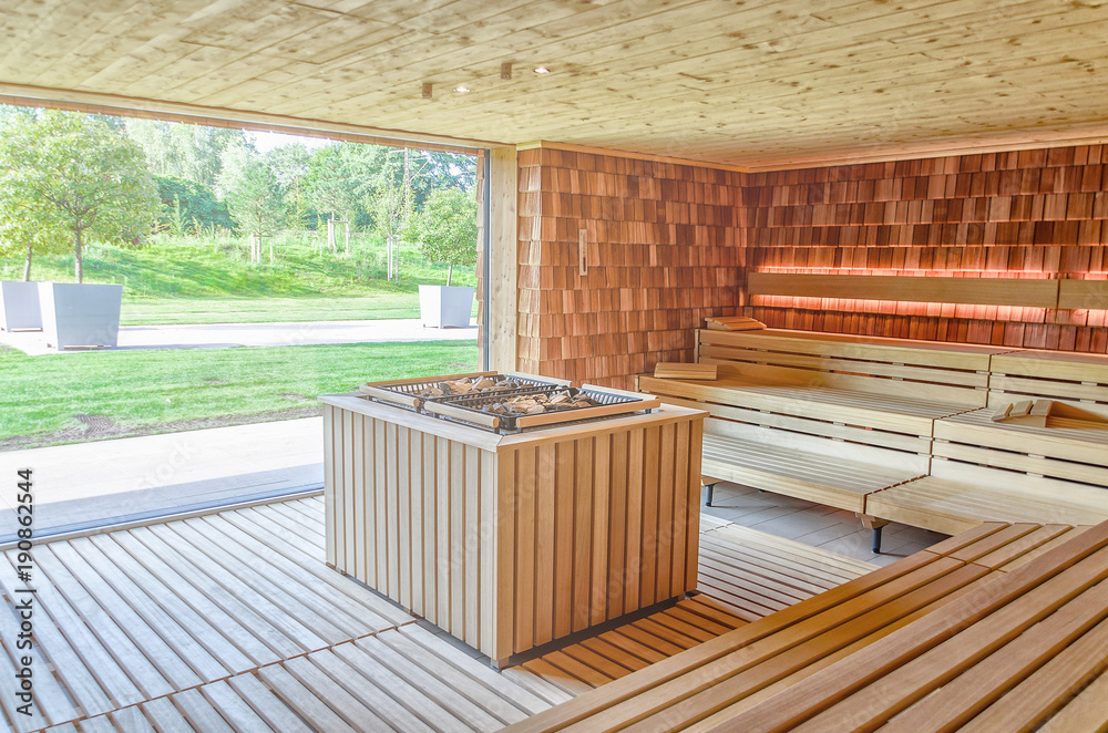 Fototapeta Dry Finnish sauna with double oven and large panoramic window