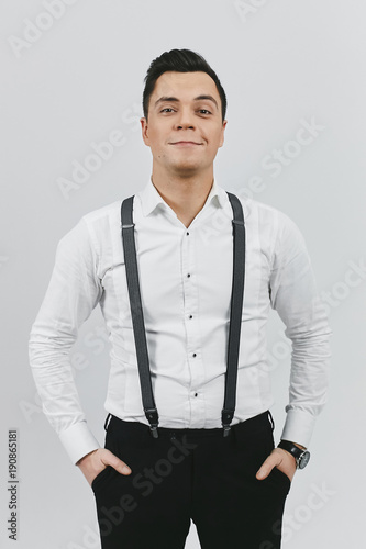 Stylish Trendy Young Brunette Man In White Shirt Black Pants And