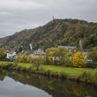 Detail of Moselle river valley with typical village houses near Trier in rainy day in November, Germany. Dark autumn landscape.