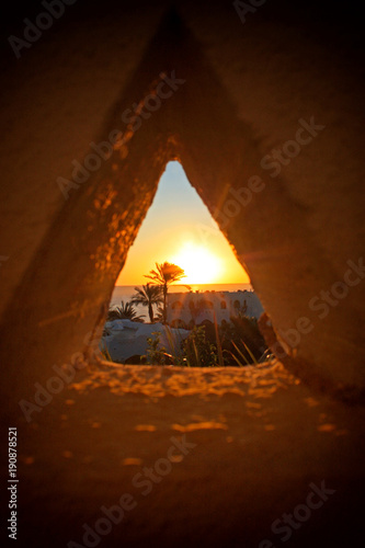 Recess Fitting Middle East View of the sunset through a triangular hole in Sharm-el-Sheikh, Egypt