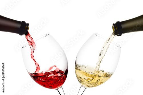 Poster Alcohol red and white wine poured from a bottle into wine glass on white background, isolated