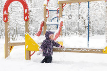 Little Child Plays On The Snow...