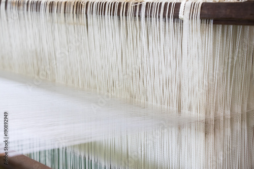 Fotografija Closed up of loom with white thread background