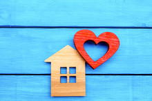 Wooden House And Red Heart On A Blue Wooden Background