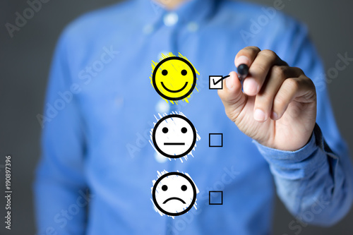 Fotomural  Businessman hand putting check mark a checkbox on excellent smiley face rating for a satisfaction survey, Customer experience concept