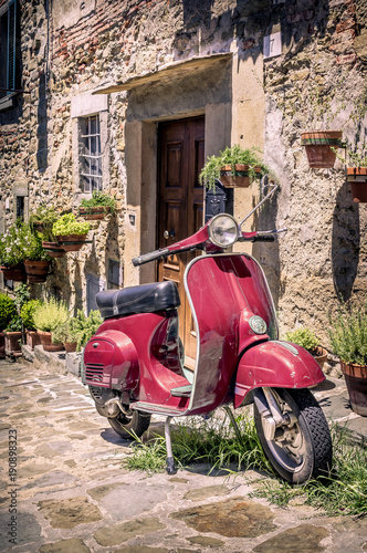 Foto op Canvas Scooter Red scooter in Tuscany