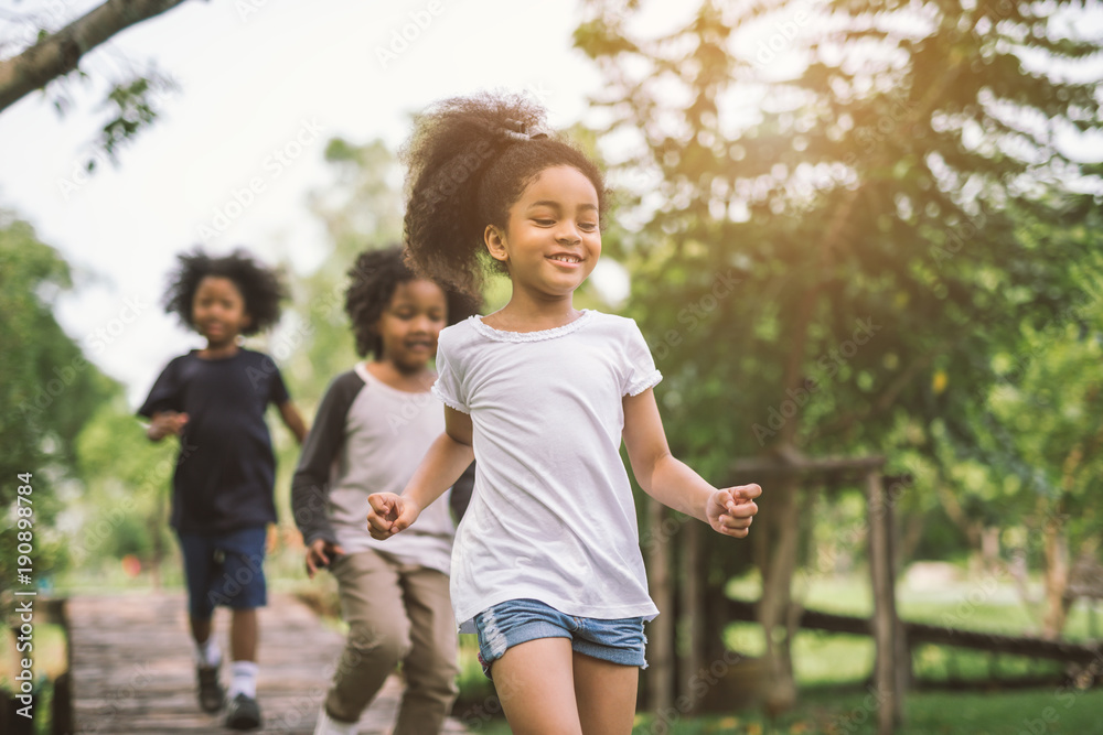 Fototapety, obrazy: Cute african american little girl playing outdoor - Black people kid and friend happy.