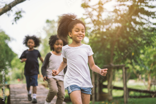 Fotografie, Obraz  Cute african american little girl playing outdoor - Black people kid and friend happy
