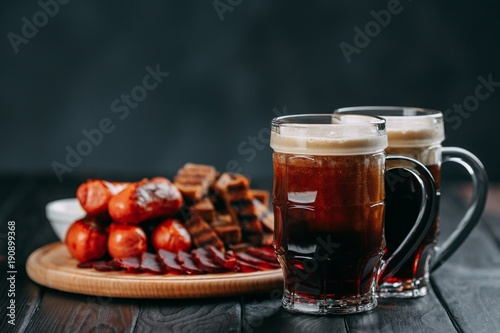 Dark beer and appetizing beer snacks set Canvas-taulu