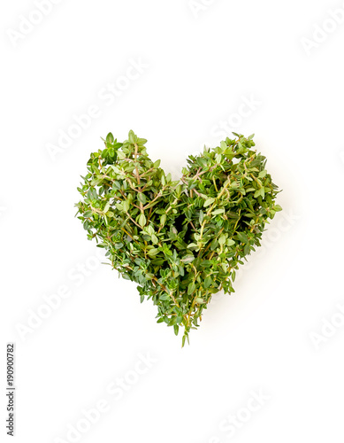 Heart of fresh thyme branches on a clean white background..