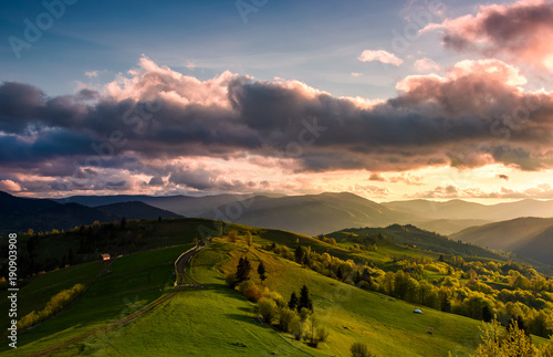 glorious cloudy sunset over rural area Wallpaper Mural