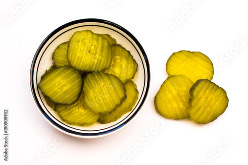 Closeup of a Bowl of Green Sliced Pickles