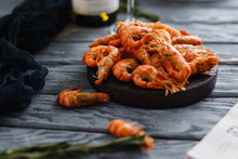 Seafood Shrimp. Close-up Of Ready-made Shrimps Lie In Plate, Dark Background. In Background. Concept Grilled Dinner