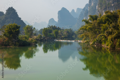 Foto auf Gartenposter Reflexion Beautiful landscape of karst mountains reflected in water, Yulong river in Yangshuo South China.