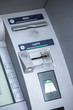 "Close-up of credit card slot on ATM with words card and receipt (""carte et recu in french"")"