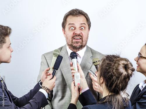 Valokuvatapetti Mature nervous politician gives interview to journalists