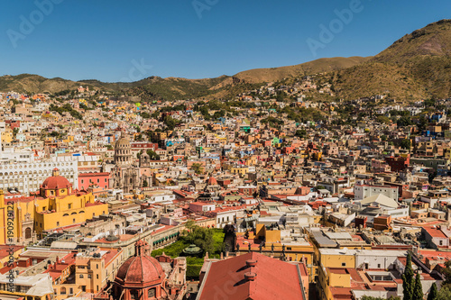 Fotografie, Obraz  Looking down on a UNESCO Heritage Site-Guanajuato City, Mexico, from up on a hil