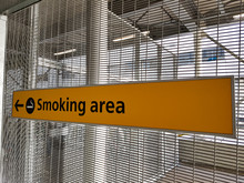 Smoking Area Sign In An Airport